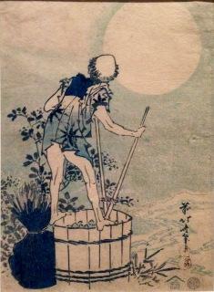Man washing potatoes